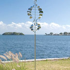 Wind Sailor Sculpture - This wind sail really feels whimsical to me. The helix shape is so wonderful because it's interesting when it's at rest but magnificent when spinning in the wind. I love that this is shiny and will splatter light all over your back yard.