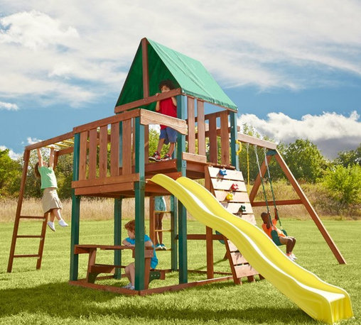 Swing-N-Slide - Swing-N-Slide Chesapeake Wood Swing Set Multicolor - PB 8243W - Shop for Swings Slides and Gyms from Hayneedle.com! The Swing-N-Slide Chesapeake Wood Swing Set is a ready-to-assemble play set with everything you need in one box. Featuring the award-winning Rapid-LOC bracket system this system is easy to assemble and all the components are included. All you need are a few common household tools. The wood is pre-cut and stained and there are six pieces of plastic coated lumber for structural stability and lower maintenance. Self-drilling fasteners are even included to eliminate drilling and a torx-head bit to assist you in building. Your children and their friends will have hours of fun on the wave side and the heavy-duty swings. There's also a ring/trapeze combo monkey bars a rock-climbing wall and more.This product carries a 5-year warranty. This warranty is valid only if the product is used for the purpose for which it was designed and installed at a residential single family dwelling. Swing N Slide products are rated and tested for residential use only.Swing Set Includes:All necessary screws nuts bolts washers bits etc. for assemblyAll necessary Rapid-LOC brackets for easy assembly2 swing seats and 6 swing hangers1 canopy1 instructional plan 1 instructional DVD8 climbing rocks1 ring/trapeze combo1 wave slide4 safety handle9 metal rungs120 pieces of pre-cut lumber6 pieces plastic coated lumber Tools You Will Need:Electric drillHammerTape measureSafety glasses and dust maskCarpenter's square About Swing-N-SlideFounded in 1985 Swing-N-Slide was America's first manufacturer of do-it-yourself wooden playground products. This remarkable company designs manufactures and distributes residential and commercial play sets across the nation. Committed to safety and driven by a desire to provide compliant fun and value-packed products Swing-N-Slide backs every play set with quality and pride. They offer unparalleled value and the unique opportunity to tailor pl