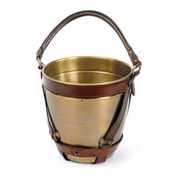 Leather Handle Champagne Bucket - Combining the brilliance of brass with the elegance of leather, this Leather Handle Champagne Bucket brings new life to what is possible with brass. The hip vintage charm of this bucket is complimented with an antiqued finish and equestrian brown leather strapping. It's a great vessel for almost any beverage that needs cooling.