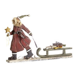SLEDDING ST. NICHOLAS - NEW - Even Santa Claus needs a hobby—and a way to burn off all of the cookies he consumes on Christmas Eve. This folksy, full-bearded statue of St. Nick and his sled full of presents is a whimsical take on the legendary guy. He's crafted entirely of wood with iron accents, hand-painted in a rustic finish that lends him a warm quality.