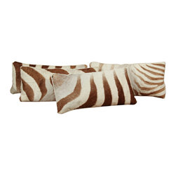 Zebra Pillows - Vintage zebra pillows are available for sofas, day beds, etc. in your house. I love the idea of reusing hides from a long time ago on the pillows. They have a softer look and color that are very appealing.