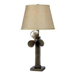 Kenroy Home - Prop Weathered Steel One-Light Table Lamp with Tan Tapered Drum Shade - -The sculptural quality found in common objects was the drive behind Prop.  Inspired, with a rich Weathered Steel finish, the mounted boat propeller adds real visual interest to a room. -3-Way Socket Switch. Kenroy Home - 32129WS
