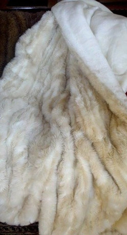 """Posh Pelts - Cougar Faux Fur Throw Blanket with Silky Soft White Faux Fur Lining - The Cougar faux fur throw blanket adds a subtle 'pizazz' to any room. The caf-au-lait and rich white stripes are variated in size and shape to add interest and dimension to this unusual throw. The lining is a wonderfully soft, silky white faux fur that will lull any napper into blissful rest. The extra large size guarantees full coverage and comfort. Although this is an oversized throw blanket, it is not a heavy blanket. It is a comfortable weight and is not bulky. PoshPelts faux fur pillow covers that complement this throw are: Arctic Fox w/brown tips, Lynx, Raccoon, Ocelot. Features: -Throw blanket. -Content: 80-85% acrylic, 15-20% polyester. -Luscious white short-pile faux fur backing. -Fibers vary and can be up to 1"""" in length. -Caf-au-lait and white stripes are different shapes and sizes; fiber lengths on the stripes differ to add dimension. -Oversized throw is 55"""" x 75"""". -Zippered plastic bag during shipment. -Machine wash cold; no heat dry; dry cleaning recommended. -Weight: 7 lbs."""