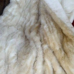 "Posh Pelts - Cougar Faux Fur Throw Blanket with Silky Soft White Faux Fur Lining - The Cougar faux fur throw blanket adds a subtle 'pizazz' to any room. The caf-au-lait and rich white stripes are variated in size and shape to add interest and dimension to this unusual throw. The lining is a wonderfully soft, silky white faux fur that will lull any napper into blissful rest. The extra large size guarantees full coverage and comfort. Although this is an oversized throw blanket, it is not a heavy blanket. It is a comfortable weight and is not bulky. PoshPelts faux fur pillow covers that complement this throw are: Arctic Fox w/brown tips, Lynx, Raccoon, Ocelot. Features: -Throw blanket. -Content: 80-85% acrylic, 15-20% polyester. -Luscious white short-pile faux fur backing. -Fibers vary and can be up to 1"" in length. -Caf-au-lait and white stripes are different shapes and sizes; fiber lengths on the stripes differ to add dimension. -Oversized throw is 55"" x 75"". -Zippered plastic bag during shipment. -Machine wash cold; no heat dry; dry cleaning recommended. -Weight: 7 lbs."