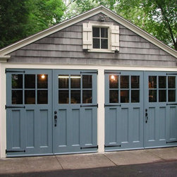 Evergreen Carriage Door - These are true carriage doors rather than garage doors. They actually swing out and have the classic attention to detail that is perfect for a more historical look.