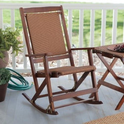 Coral Coast Willow Bay Folding Resin Wicker Rocking Chair - Walnut - For warmth and style on the porch we suggest the Coral Coast Willow Bay Wicker Rocking Chair in Walnut. The seat features tightly woven all-weather resin wicker for comfort and relaxation. This woven style is mimicked on the backrest so it looks beautiful from any angle. Designed with quality in mind this rocking chair boasts a durable wood and all-weather resin wicker construction for years of durability. Its walnut finish will give your porch an appealing look. It's easy to clean too - just wipe it down with a damp cloth and some soapy water. Dimensions Seat Bottom Only dimensions: 16W x 18D inches Interior width from arm to arm: 18W inches About Coral Coast What if when you closed your eyes you pictured yourself in your own backyard? Coral Coast has a collection of easygoing affordable outdoor accessories for your patio pool or backyard. The latest colors and styles mingle with true classics in weather-worthy fabrics and finished woods ready for relaxation. Make yours a life of leisure.