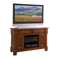 Home Styles - Home Styles Aspen TV Stand - Home Styles - TV Stands - 552009 - Create ambiance with a perfect balance of warmth and style with the Aspen Collection.  Poplar solids and cherry veneers are warmed with a multi-step Rustic Cherry finish while recessed door panels a profiled edge top bold molding detail and Marlborough styled feet draw the eye deeper in.  The Aspen TV Stand provides generous storage in the center cable accessible storage compartment with an adjustable shelf; two storage cabinets each with an adjustable shelf; and two storage drawers.