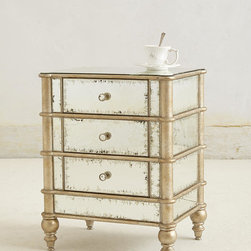 Mirrored Nightstand - Mirrored surfaces add a dose of glamour to any interior space, and this perfectly sized three-drawer nightstand is no exception. A lightly blemished patina lends a vintage appeal that fits both modern and traditional bedrooms.