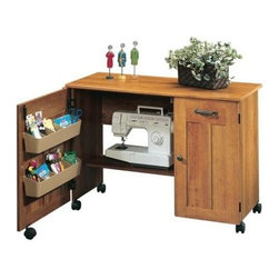 Sauder - Sewing & Craft Table in American Cherry Finis - Drop leaf provides extra work space for sewing or crafts. Storage behind roll-open door includes 2 storage bins and hidden shelf for sewing machine. 2 Adjustable shelves behind door. Melamine top surface is heat, stain and scratch-resistant. Easy-roll casters. Made of engineered wood. Assembly required. 40 in. W x 19 in. D x 29 in. H