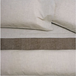 Area - Heather Natural Fitted Sheet - Fancy heathered beige yarns woven into a soft cotton percale. Subtle pleat detail on flat sheets and cases. Mini flange detail all around duvet covers and shams. Shown with HARRY-almond cotton blanket.