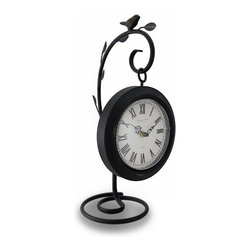 Zeckos - 7 Inch Diameter Hanging Table Clock W/ Bird on Branch Hanger - The clock hangs from a black enamel coated wrought iron hanger with a leafy branch and songbird theme. With the hanger, the clock measures 16 inches tall, 8 1/2 inches long and 7 inches wide. The quartz movement runs on a single AA Battery (not included) It looks great on side tables, on top of desks and on bookcases.