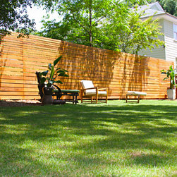 The Skyline Wood Privacy Fence - These images are of the Skyline Wood Privacy Fence installed by Fence Workshop™. These images show off the quality craftsmanship, planning and hard work it took to properly install this style of fence.