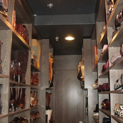 Spectacular Man's shoe closet - Beautiful grey wood grain shoe shelves make it easy to find and store anyone's collection of shoes, luggage and accessories, but in this case the owner is a man!  Glad to see a man that is as passionate about his shoes as we ladies are!