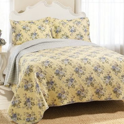 Laura Ashley Linley Reversible Quilt Set - The Laura Ashley Linley Reversible Quilt Set is the perfect complement to traditional-style bedrooms or lighter color palettes. Included in this set is a quilt and two matching pillow shams (one sham with twin size), each made from soft 100% cotton. A classic floral pattern in muted blues and greens is set against a pastel yellow background; the quilt features plush cotton fill and a reversible light-blue-and-yellow pattern. Twin, full/queen, and king sizes are all available.About Laura AshleyFounded in Great Britain, Laura Ashley is known for its historic and coveted British fabrics, wallpapers, and cushions. It has recently expanded to North America to offer a full range of global products for the home and garden.