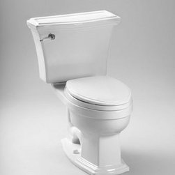 """Toto - Toto CST784EF#01 Cotton Eco Clayton Eco Clayton Two Piece Elongated - 1.28GPF ADA Compliant Two-Piece Elongated Toilet (Less Seat) When it comes to Toto, being just the newest and most advanced product has never been nor needed to be the primary focus. Toto s ideas start with the people, and discovering what they need and want to help them in their daily lives. The days of things being pretty just for pretty s sake are over. When it comes to Toto you will get it all. A beautiful design, with high quality parts, inside and out, that will last longer than you ever expected. Toto is the worldwide leader in plumbing, and although they are known for their Toilets and unique washlets, Toto carries everything from sinks and faucets, to bathroom accessories and urinals with flushometers. So whether it be a replacement toilet seat, a new bath tub or a whole new, higher efficiency money saving toilet, Toto has what you need, at a reasonable price. Vitreous china elongated two piece toilet with 12"""" rough-in. Low consumption (4.8 Lpf/1.28 Gpf) siphon jet flushing action. Tank cover, fittings, color matched and chrome plated trip lever, mounting covers included, less seat.  Seat Not Included Traditional design two piece toilet Universal height for maximum comfort E-Max  Flushing System (1.28GPF / 4.8 LPF) Upgrade with a Traditional SoftClose  seat or a Washlet  Fast Flush: Wide 3"""" flush valve is 125% larger than conventional 2"""" flush valves ADA Compliant Large water surface"""