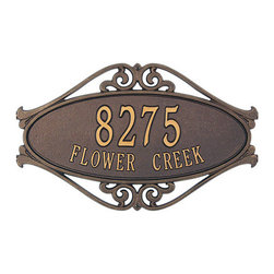 Hackley Fretwork Address Plaque - Add a touch of class to your home or business with this eye-catching address plaque. Symmetrical scrollwork flanks an oval face that holds up to five numbers. Rust-free recycled aluminum and weather resistant paint make this a long lasting addition with big impact.