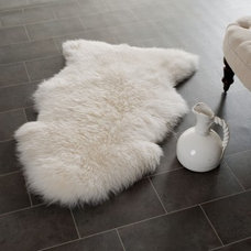 Traditional Rugs by StudioLX