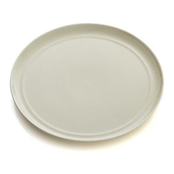 Hue Ivory Dinner Plate - Our fresh, contemporary porcelain pattern from designer Aaron Probyn tells a mix 'n' match color story, hand-glazed in eight soft, soothing hues. Simple artisanal shapes feature grooved detailing and a glowing, glossy finish, here in creamy ivory. Due to their handcrafted nature, slight variations will be present. Also available in white, dark grey, taupe, blue, green, light grey and blush.