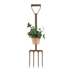 Garden Fork Planter - Classic garden annuals will give this unusual planter a charming, traditional cottage feel. Its rusty appearance makes it perfect for accenting a quaint patio, but it can also be mounted on the wall for use indoors.