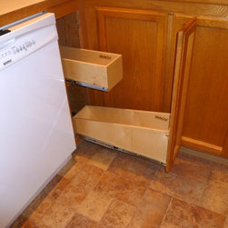 Base Cabinets and Other Creative Solutions - Make better use of your oddly shaped and interestingly sized cabinets.  This tiny cabinet was hard to access, but add pull out shelves and attached the door to the front of the pull out shelf to open up space and you have a much easier-to-access space.
