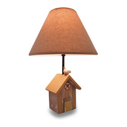 Zeckos - Weathered Finish Wooden Beach Shack Lamp with Fabric Shade - This wooden beach shack lamp bears the weathered markings and additional charms of a long life by the ocean while a sea loving feathered friend takes up residence perched atop the roof. Measuring 17.5 inches high, 5.5 inches long and 3.75 inches wide (44 X 14 X 10 cm), it's great on the nightstand in your bedroom or the guest room, in the entryway, or next to your favorite lounging spot, and it includes a 7.5 inch high, 12 inch diameter (19 X 30 cm) fabric shade. It uses 'type A' bulbs up to 40 watts, and easily turns on or off using the in-line thumbwheel switch on the 60 inch long power cord. This lamp is a salty addition to any room, and makes a wonderful housewarming gift for ocean, beach or nautical lovers sure to be admired