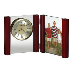 """Howard Miller - Howard Miller Alex Picture Frame Alarm Clock - Howard Miller - Mantel / Table Clocks - 645618 - This contemporary picture frame alarm clock has a naturally warm character and offers both timekeeping and a cherished moment for your bedside. Distinguished by its rosewood columns and floating two-tone dial on clear glass panel the Alex is an attractive complement. A full-view frame holds a standard 4 x 6 """" photo and the dial further features a polished gold-tone bezel and circular brushed silver-tone numeral ring. Battery-operated quartz alarm movement completes the appeal of the Alex Picture Frame Alarm Clock."""