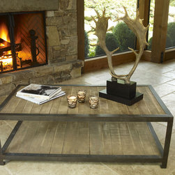 Aspen Rustic Wood Coffee Table - Hand crafted of iron and rustic wood, this is a coffee table that can withstand the demands of game night, football playoffs, spilled salsa and muddy boots. The lower shelf is the same size as the top for twice the display and storage space.