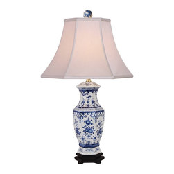 "Lamps Plus - Asian Floral Blue And White Table Lamp - This charm-filled table lamp features a blue and white botanical print on a slim urn-style base. A rayon bell shade with ribbing softens the glow of the bulb while providing a curved element to the design. A delightful accent lamp to instantly add pattern and floral appeal to your decor! Floral table lamp. Blue and white finishes. Rayon bell shade with ribbing. Rotary switch. Takes one 100 watt 3-way bulb (not included). 26"" high. Shade is 7"" across the top 14"" across the bottom 11"" on the slant. Base footprint is 6"" round.  Floral table lamp.  Blue and white finishes.  Rayon bell shade with ribbing.  Rotary switch.  Takes one 100 watt 3-way bulb (not included).  26"" high.  Shade is 7"" across the top 14"" across the bottom 11"" on the slant.  Base footprint is 6"" round."