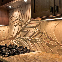 Artistic Elements - This is a 8' mosaic made with Travertine, river rock and copper.
