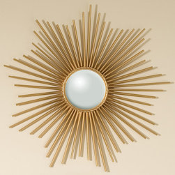 Mini Sunburst Mirror - Gold - Balmy, hopeful mood comes into a room that is accented with the Mini Sunburst Mirror, a beautiful metallic gold wall accent with a scalloped placement of thin metallic rods assembled into a gorgeous array against your wall.  The transparent construction and rippling edges emphasize the harmonious circular form of the central mirror pane, a bright jewel of light in your space.