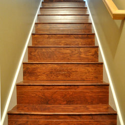 Cottonwood Heights - Newly installed Stained Cherry laminate flooring on the stairs. Floorboards and stairnosing used.
