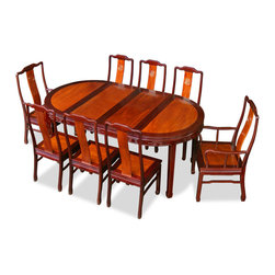 "China Furniture and Arts - 80in Rosewood Longevity Design Oval Dining Table with 8 Chairs - Exhibiting its pleasing simple lines in a distinct Ming (1368-1644) style, this exquisite dining set is intricately carved in Chinese Key with longevity symbols. Completely handmade with solid rosewood by artisans in China using traditional joinery technique. Two 18""W removable leaves for your convenience. Its natural rosewood finish with mahogany trim round out its quiet beauty."