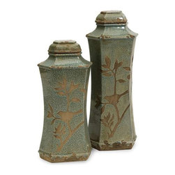 Marsh Lidded Vases - Set of 2 - Style and grace are evident in the natural beauty of this set of two vases. Exposing a birds silhouette on a delicate branch, the simplified body and subtle shade of the Marsh lidded vases add a serene feeling to any home.