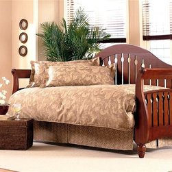 Leggett/Platt Fashion Bed - Fraser Daybed in Walnut Finish - A classic keyhole pattern on the slats gives this traditional daybed an elegant look that will easily enhance your home's decor. Ideal for seating, afternoon naps or overnight guests, the daybed is crafted of wood in walnut finish and features bold curves for added visual interest. Includes bed frame and linkspring. Curved camel back and the arms curve out. The back and arms comprised of 3 5/8 in. wood slats set one inch apart with a keyhole pattern carved in the center slats of the back and all the slats of the arms. The front of the arms bow out at the bottom and end in delicately carved feet. Made of Poplar and MDF. Suitable for both seating and sleeping. 41.125 in. W x 89.375 in. D x 49.5 in. H (114 lbs.)