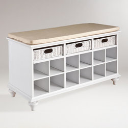 World Market - White Oakdale Shoe Bench - Keep your shoes from blocking your entryway or bedroom closet with our beautiful White Oakdale Shoe Bench. This durable hardwood bench features 12 shoe shelves, plus three substantial rattan pull out drawers for gloves, scarves and other essentials. With an elegant cream bench cover and a modern white finish, this handy storage solution makes the most of your space in fine style.