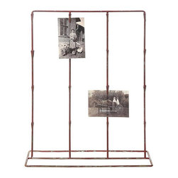 Vintage Style Red Clip Stand - Set up your own intriguing display of photos, postcards, and paper ephemera on this antique-inspired stand. A reproduction of old corner store chip stands, the rusty red finish and 32 small clips give you a chance to create your own artwork.