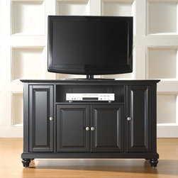 """Crosley - Cambridge 48"""" TV Stand - Enhance your living space with one of Crosley's impeccably-crafted TV stands. This signature cabinet accommodates most 50'' flat panel TVs and is handsomely proportioned featuring character-rich details sure to impress. Raised panel doors strategically conceal stacks of CDs/DVDs, gaming components and various media paraphernalia. Open storage area generously houses media players and the like. Adjustable shelving offers an abundance of versatility to effortlessly organize by design, while cord management systems tame the unsightly mess of tangled wires. Customize our distinct cabinets by selecting one of four collection styles (featuring tapered, traditional. turned or bun feet) in your choice of one of three signature Crosley finishes. This customizable cabinet approach is designed for easy assembly, built to ship and constructed to last. Features: -Raised panel doors.-Five adjustable shelves for storing electronic components, gaming consoles, DVDs and other items.-Adjustable levelers in legs.-Recommended TV Type: Flat screen.-TV Size Accommodated: 48"""".-Powder Coated Finish: No.-Gloss Finish: No.-Material: Hardwood and veneers.-Solid Wood Construction: No.-Distressed: No.-Exterior Shelves: Yes -Number of Exterior Shelves: 1.-Adjustable Exterior Shelves: No..-Drawers: No .-Cabinets: Yes -Number of Cabinets: 3.-Number of Doors: 4.-Door Attachment Detail: Pin hinge.-Interchangeable Panels: No.-Magnetic Door Catches: Yes.-Cabinet Handle Design: Knob.-Number of Interior Shelves: 5.-Adjustable Interior Shelves: Yes..-Scratch Resistant : No.-Removable Back Panel: No.-Hardware Finish (Finish: Black): Brushed nickel knobs, steel hardware.-Hardware Finish (Finish: Classic Cherry): Antique brass knobs, steel hardware.-Hardware Finish (Finish: Vintage Mahogany): Antique brass knobs, steel hardware.-Casters: No .-Accommodates Fireplace: No.-Fireplace Included: No .-Lighted: No .-Media Player Storage: Yes.-Media Storage: No .-Cable Management: H"""