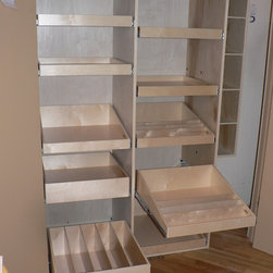 Closet and Walk-In Pantries - The tray bin and a divided pull out shelf are shown extended above for a better view.  Create the customized pantry of your dreams with pull out shelves from ShelfGenie of Seattle.