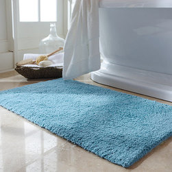 """Frontgate - Skid-resistant AirDrop Tufted Bath Rug - Aropical weight towel that is supersoft, highly absorbent, and quick to dry. Combines exceptional absorbency with long-wearing durability. Many layers of air result in a towel with superior thickness. 56% more absorbent than conventional towels. More effective on hair drying, saving time and energy. AirDrop is the most innovative bath towel on the market. Created using an advanced technique that transforms conventional cotton into a highly absorptive and quick-drying material by trapping it with air. Then, the yarn is twisted with conventional cotton yarns, resulting in an incredibly soft, plush, and light towel.  .  .  .  .  . Hypoallergenic towels lose fewer fibers, which is beneficial for seniors, infants, and sensitive asthmatics . The air inside the yarns acts as an insulator, so the towel feels warmer around the body . Remains very soft, fluffy, and smooth throughout its life . Personalization is available on the 4"""" dobby . Coordinating Bath Rugs are woven of 100% cotton with a nonskid latex back . Machine wash; tumble dry recommended . Made in Portugal."""
