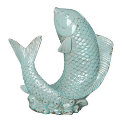 Emissary - Upright Koi in Distressed Torquoise - The naturally graceful shape of a koi is captured in this beautiful and classic sculpture. A hand-applied glaze gives the ceramic piece a distressed turquoise look