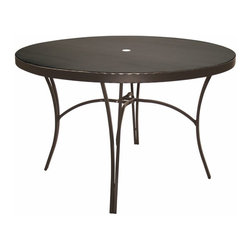 Homecrest - Homecrest Legendary 54 in. Round Patio Dining Table - 7858D-03-65 - Shop for Tables from Hayneedle.com! Enliven your outdoor area with the Homecrest Legendary 54 in. Round Patio Dining Table. Constructed from durable steel material this handsome round table completes any patio deck or outdoor space. Crafted for year-round enjoyment the sturdy steel material features all-weather resilience that won't fade rot or crack from exposure to inclement elements.A subtle blend of classic patio style with modern luxury makes this round dining table a versatile addition to any space. The minimal design effortlessly blends with any existing decor without overpowering the space and the central umbrella port lets you dine in the sun or shade. Choose from a variety of frame finishes and table colors for the table that best complements your home.About Homecrest:The Homecrest brand was founded in 1953 as the offspring of a retail furniture shop in Wadena Minnesota when Mert Bottemiller and Al Engelmann set out to offer the market a better ottoman than those offered by their competitors. This venture soon led to their first line of patio furniture and in 1956 Bottemiller patented the swivel rocker mechanism that is still a central part of the products they produce today from their plant in Minnesota. For almost 60 years the Homecrest brand has been the go-to name for quality outdoor furniture when customers want a sophisticated versatile style that complements their interior decor and expands their lifestyles outside.