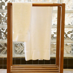 Teak Towel Stand for Bathroom or Spa - This handcrafted teak towel stand or teak pool rack is built to last. It is a beautiful addition to the teak in your bathroom. Nice to place towels close to the shower. Also nice in the garden next to the jacuzzi or pool.