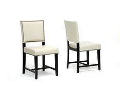 Wholesale Interiors - Nottingham Cream Modern Dining Chair-Set of 2 - Set of 2. Cream faux leather seat. Wooden frame with black legs. Firm, dense polyurethane foam cushioning. Antiqued nail head trim. Made in Malaysia. Assembly required. 17.75 in. L x 21.5 in. W x 42.75 in. H (20.5 lbs)