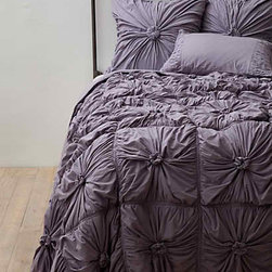 Anthropologie - Rosette Quilt, Lavender - The Rosette quilt has always been a favorite of mine, and I am loving it in this year's color.