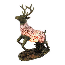 Stained Glass 8 Point Deer Accent Lamp Buck - This beautiful stained glass deer shaped lamp adds the perfect accent to desks or nightstands of nature lovers. Measuring 13 inches tall, 12 inches long and 2 1/2 inches wide, the lamp features an antiqued bronze finished cold cast resin base of the head, tail and waves, with the deer`s body made up of mottled white glass, so the light casts a soft glow. The lamp is brand new, never used or displayed. It uses nightlight style bulb (included). It makes a great gift idea. We have a very limited supply of these, so don`t delay. Get yours now!