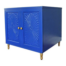 Used Hollywood Regency Style Blue Cabinet - This unique vintage piece has sun centric carvings on the front of the doors giving it an eclectic feel. The marble top would make this a nice little bar or an end table. You'll never need a coaster! It has an extra pop of glam with a stunning gold interior.