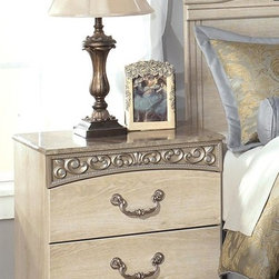 Signature Design by Ashley - Nightstand in Chestnut Grain - Light Brown finish. Light opulent color over replicated Grand Chestnut grain. Curving friezes with deeply carved scroll motifs in a champagne color tipping. Large scaled bail with rosettes in a dark champagne color finish. Traditional base rail cut out details. Side roller glides for smooth operating drawers. Assembly Instructions. 25 in. W x 16 in. D x 26 in. H