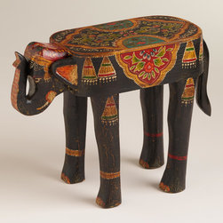 Painted Elephant Wood Accent Table - How cute is this elephant accent table? When decorating a room, I always add an unusual piece to create some interest and give the room a little surprise.
