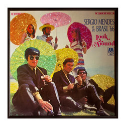 """Glittered Sergio Mendes Album - Glittered record album. Album is framed in a black 12x12"""" square frame with front and back cover and clips holding the record in place on the back. Album covers are original vintage covers."""