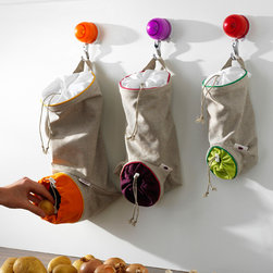 Orka by Mastrad Vegetable Keep Sacks - These reusable bags are perfect for keeping potatoes, ginger, onions and garlic out of the way and out of the light. I think the drawstring bottom is ingenious. I won't be throwing away sprouted potatoes or shriveled garlic anymore.